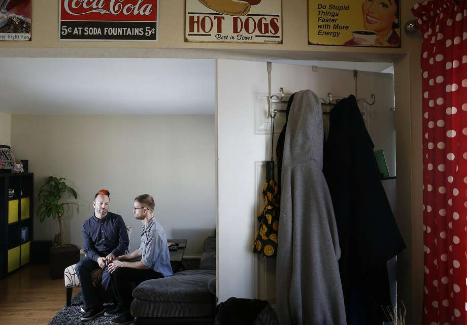 From left, Jeramie and Andrew Andehueson pose for a portrait in their apartment Nov. 11, 2015 in Alameda, Calif. The Andehueson's moved to the Bay Area from South Dakota to pursue their careers and eventually a family. Last week, after only a year at their apartment, they received an eviction notice with no explanation on their door. Photo: Leah Millis, The Chronicle