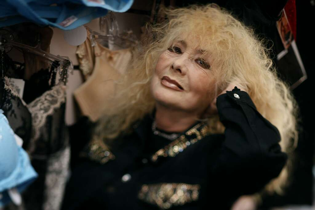 Legendary North Beach stripper Carol Doda works at her Champagne and Lace  lingerie shop in San