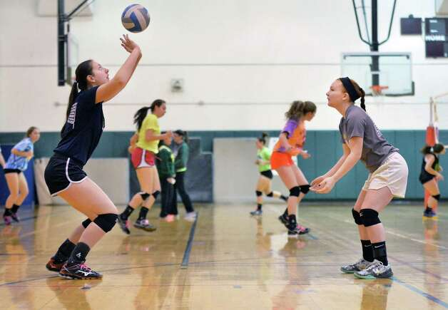 Shenendehowa girls' volleyball team players Nicole Adams, left, and Charlotte Macken practicing for their upcoming Class AA regional Wednesday Nov. 11, 2015 in Clifton Park, NY.  (John Carl D'Annibale / Times Union) Photo: John Carl D'Annibale / 00034185A