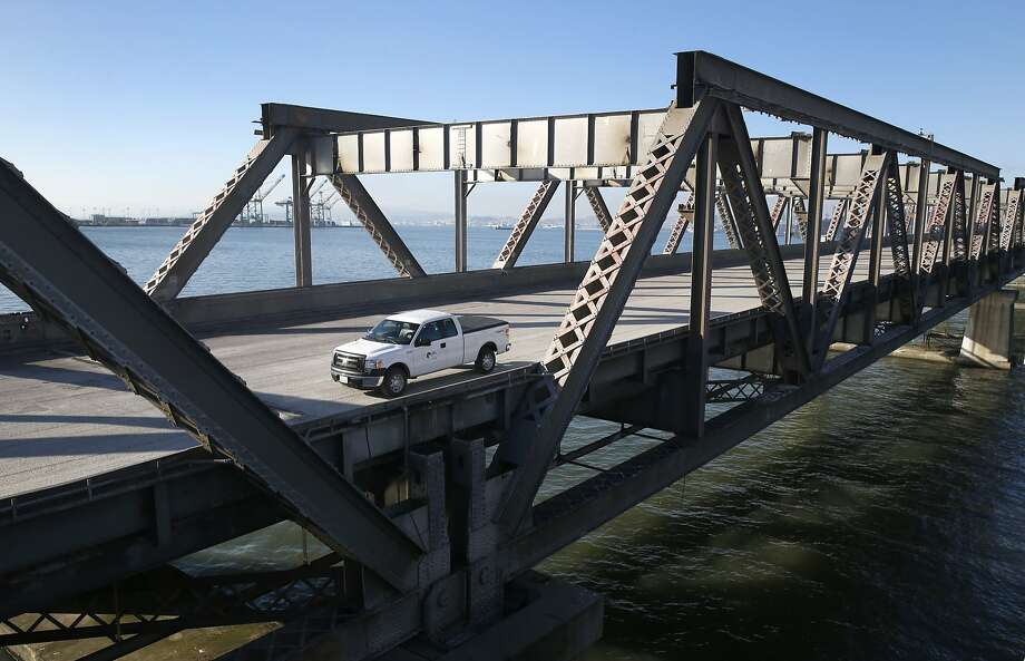 A vehicle from the contractor dismantling the old Bay Bridge drives off the span while a crew prepares an implosion of the E-3 pier in San Francisco, Calif. on Wednesday, Nov. 11, 2015. A demoliton team will detonate a number of charges below the surface of the bay to demolish the old piling on Saturday morning. Photo: Paul Chinn, The Chronicle