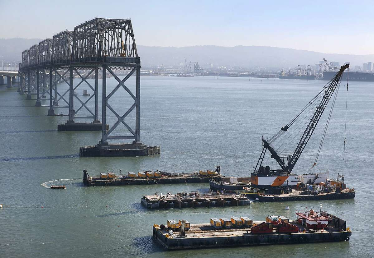 Preparations for an implosion continues on the E-3 pier of the old Bay Bridge in San Francisco, Calif. on Wednesday, Nov. 11, 2015. A demoliton team will detonate a number of charges below the surface of the bay to demolish the old piling on Saturday morning.