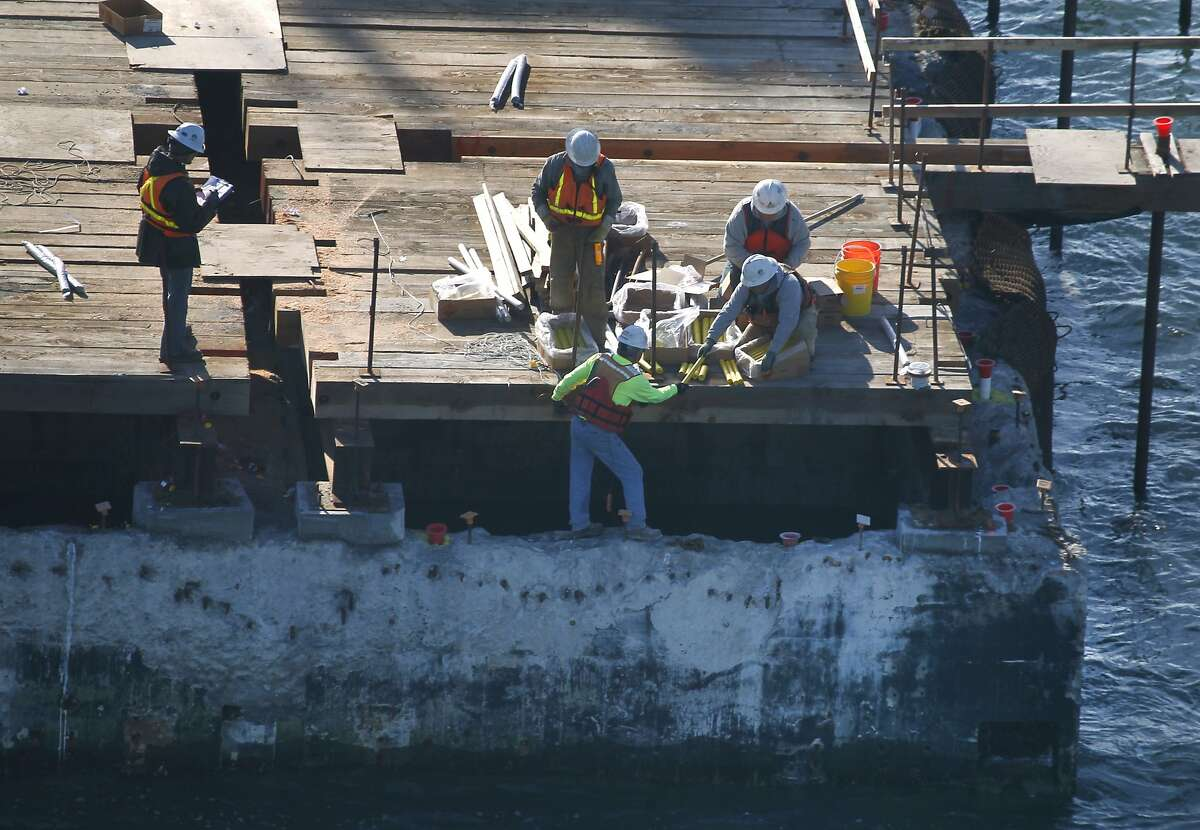 A demolition crew prepares an implosion of the E-3 pier of the old Bay Bridge in San Francisco, Calif. on Wednesday, Nov. 11, 2015. Crews plan on detonating a number of charges below the surface of the bay to demolish the old piling on Saturday morning.