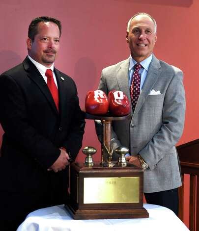 RPI Football Coach Ralph Isernia, left, and Union Football coach John Audino pose with the Dutchman's Shoes Trophy during the media luncheon Wednesday afternoon, Nov. 11, 2015, to promote the annual Dutchman Shoes football game this Saturday at Union University in Schenectady, N.Y.  (Skip Dickstein/Times Union) Photo: SKIP DICKSTEIN / 00034195A