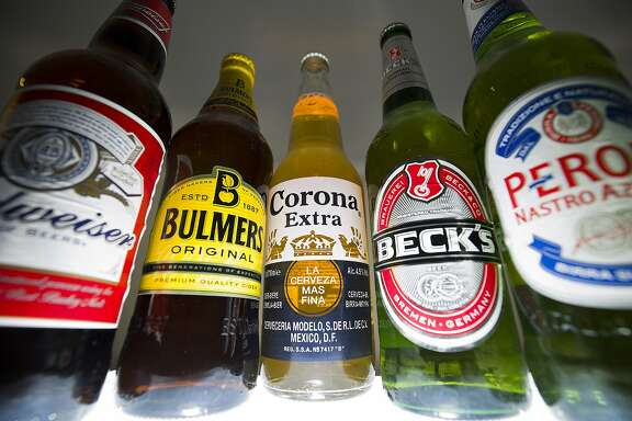 (FILES) A file picture taken in London on October 13, 2015, shows bottles of beer and cider produced by Belgian-Brazilian group Anheuser-Busch InBev, (Budweiser, Corona and Beck's) and British brewer SABMiller (Peroni and Bulmers). The world's biggest brewer Anheuser-Busch InBev on Wednesday November 11, 2015, said it had reached formal agreement on a mega-takeover of its nearest rival, Britain's SABMiller, for $121 billion (112 billion euros) including debt.  AFP PHOTO / JUSTIN TALLIS/FILESJUSTIN TALLIS/AFP/Getty Images