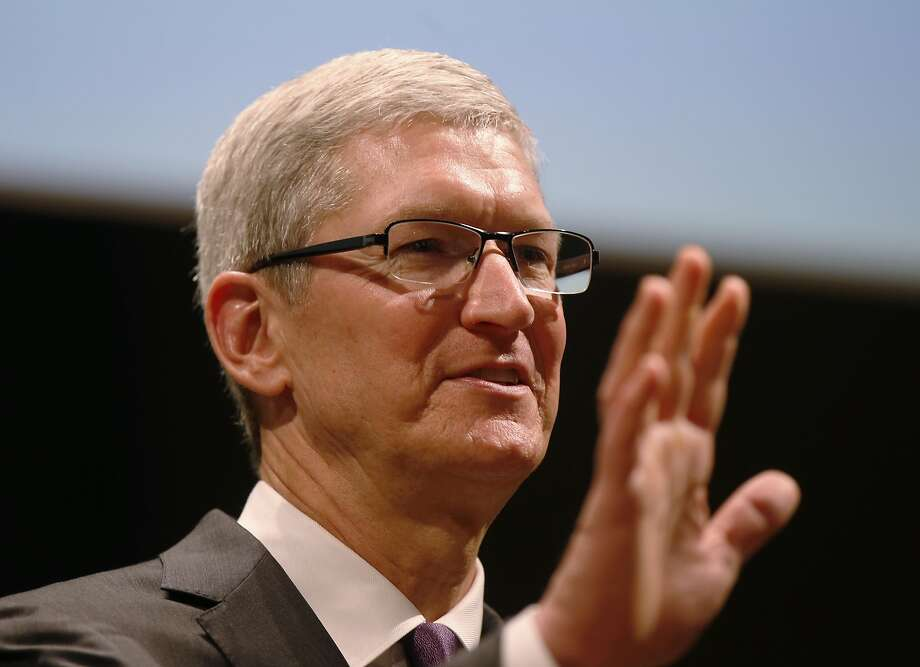 "Apple CEO Tim Cook attends the inauguration of the academic year at the Bocconi University, in Milan, Italy, Tuesday, Nov.10, 2015. On Tuesday, Cook issued a firm stand against the ruling of a federal magistrate who ordered the company to build a ""backdoor"" to its iPhones so that investigators could hack into the phone of one of the San Bernardino shooters. Photo: Luca Bruno, Associated Press"