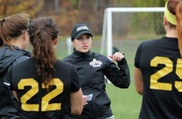 Coach Caitlin Cucchiella, center, who is originally from Colonie, talks to her players as the University at Albany women's soccer team prepares for their first ever trip to the NCAA Tournament on Wednesday, Nov. 11, 2015 in Albany, N.Y.  (Lori Van Buren / Times Union) Photo: Lori Van Buren / 00034170A