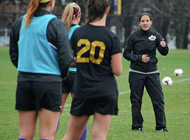 Coach Caitlin Cucchiella, who is originally from Colonie, talks to her players as the University at Albany women's soccer team prepares for their first ever trip to the NCAA Tournament on Wednesday, Nov. 11, 2015 in Albany, N.Y.  (Lori Van Buren / Times Union) Photo: Lori Van Buren / 00034170A