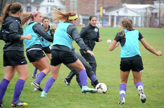 Coach Caitlin Cucchiella, second from right, works with her players as the University at Albany women's soccer team prepares for their first ever trip to the NCAA Tournament on Wednesday, Nov. 11, 2015 in Albany, N.Y.  (Lori Van Buren / Times Union) Photo: Lori Van Buren / 00034170A