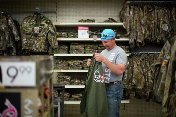 Kevin Lowe, shops for warm clothing in the hunting section of the sports good store Academy, Tuesday, Nov. 10, 2015, in Houston. ( Marie D. De Jesus / Houston Chronicle )