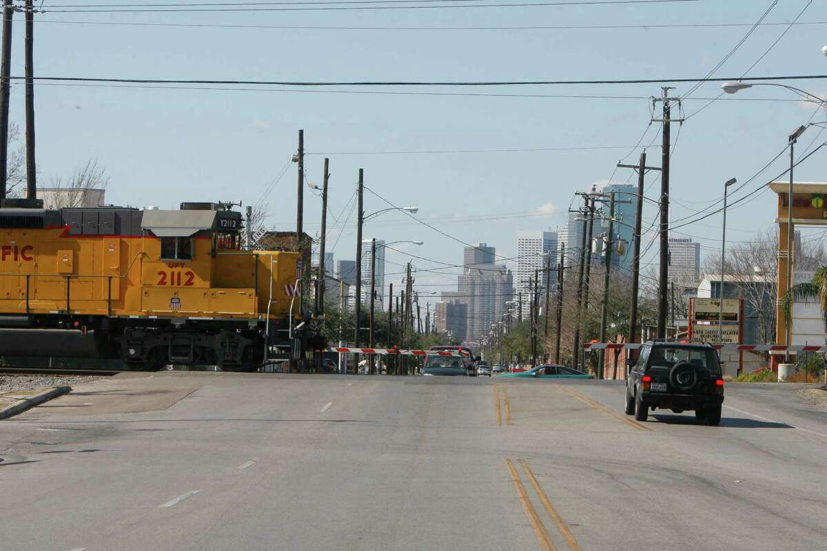 Guard rails are seen down as an approaching train is about to cross on the track at Harrisburg Boulevard near Hughes Street in Houston's East End on Feb. 5, 2009. At the time, residents were vehemently opposed to a six-block long overpass.