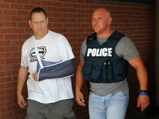 Officer Chad Klein, left, was one of many fellow police officers, friends and family who showed up for support as Troy Police Officer Joshua Comitale was released from Albany Medical Center on Monday, Aug. 31, 2015 in Troy, N.Y. Comitale and Officer Chad Klein were both shot when Thaddeus Faison, 39, opened fire Aug. 22. Faison was killed in the 10:45 p.m. shootout at 112th Street and Fifth Avenue. (Lori Van Buren / Times Union) Photo: Lori Van Buren / 00033185A
