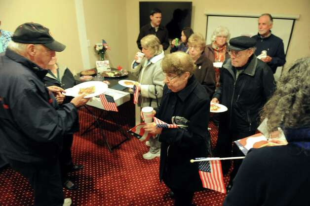 Guest enjoy refreshments in a community room on Wednesday, Nov. 11, 2015, at the Dominick Pitaniello Veteran and Community Housing in Troy, N.Y. The facility is named in honor of Pitaniello, who was killed in action as a young man during WWII. (Cindy Schultz / Times Union) Photo: Cindy Schultz / 00034105A