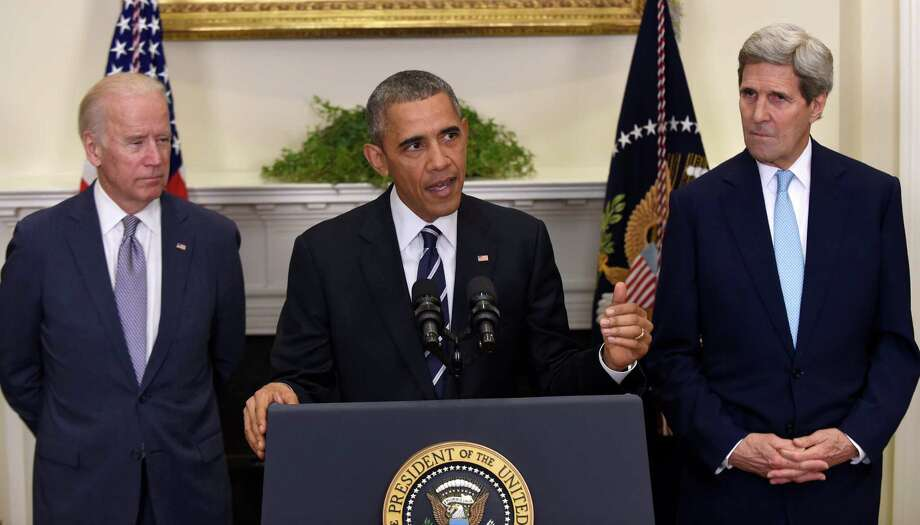 President Barack Obama, accompanied by Vice President Joe Biden and Secretary of State John Kerry, announces he's rejecting the Keystone XL pipeline because he does not believe it serves the national interest, in the Roosevelt Room of the White House in Washington. (AP Photo/Susan Walsh, File) Photo: Susan Walsh, AP / AP
