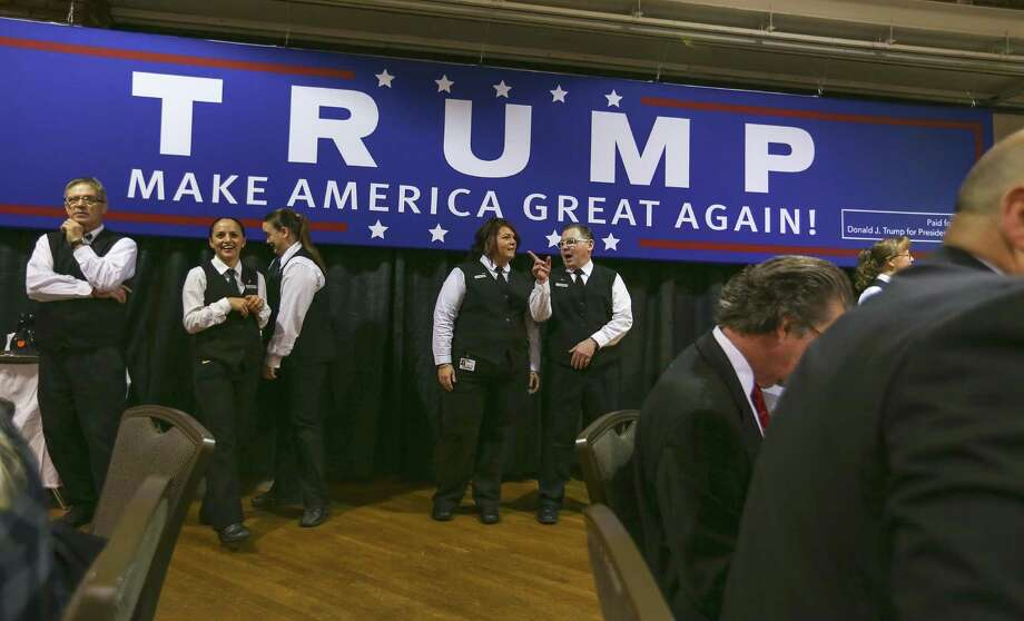 Servers wait to start bringing in breakfast at Politics and Eggs in Manchester, N.H., Wednesday, Nov. 11, 2015. Republican presidential candidate Donald Trump spoke at the event which was hosted by New England Council and NH Institute of Politics.  (AP Photo/Cheryl Senter) Photo: Cheryl Senter, FRE / FR62846 AP
