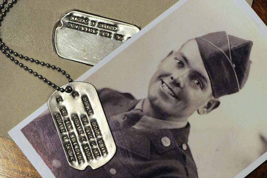 Elmer D. Stone's original dog tag was found in the garden of a home in Sutton Veny, England, earlier this year. Stone's son, Tom, used the replacement dog tag Elmer had gotten after being injured in World War II, to match up the serial numbers.  Photo: Tommy Metthe, MBR / The Abilene Reporter-News