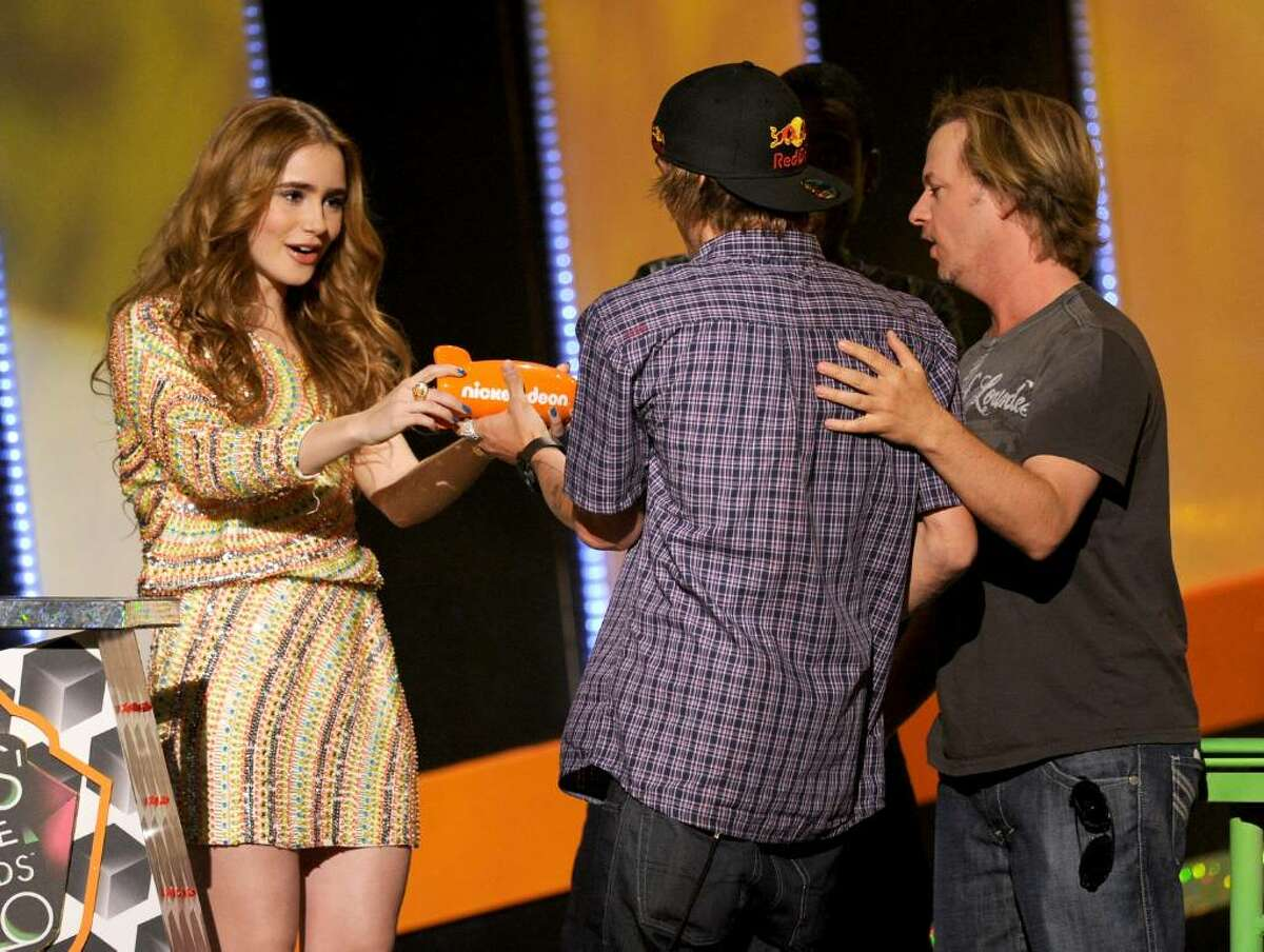LOS ANGELES, CA - MARCH 27: Actress Lily Collins, Ryan Shekler, and actor David Spade speak onstage at Nickelodeon's 23rd Annual Kids' Choice Awards held at UCLA's Pauley Pavilion on March 27, 2010 in Los Angeles, California. (Photo by Kevin Winter/Getty Images for KCA) *** Local Caption *** Lily Collins;Ryan Sheckler