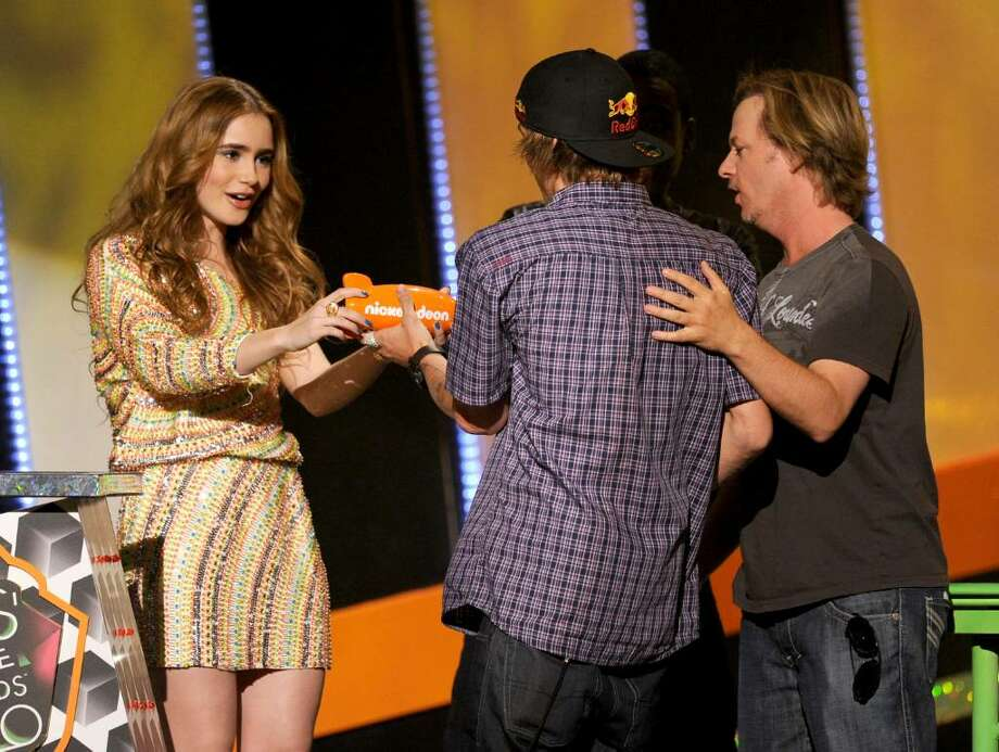 LOS ANGELES, CA - MARCH 27:  Actress Lily Collins, Ryan Shekler, and actor David Spade speak onstage at Nickelodeon's 23rd Annual Kids' Choice Awards held at UCLA's Pauley Pavilion on March 27, 2010 in Los Angeles, California.  (Photo by Kevin Winter/Getty Images for KCA) *** Local Caption *** Lily Collins;Ryan Sheckler Photo: Kevin Winter, Getty Images For KCA / 2010 Getty Images