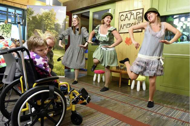 "Patients and families enjoy the Park Playhouse's production of ""A Year with Frog and Toad"" at the Bernard & Millie Duker Children's Hospital on Wednesday, Nov. 11, 2015, at Albany Medical Center in Albany, N.Y. The performers, from left, are Emma Kron-Deacon, Meredith Myers and Julia Franklin. (Cindy Schultz / Times Union) Photo: Cindy Schultz / 00034207A"