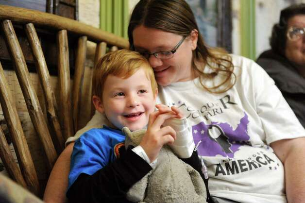 "Caleb DeLaet, 6, of Middleburg, left, and his mother, Amber DeLaet enjoy the Park Playhouse's production of ""A Year with Frog and Toad"" at the Bernard & Millie Duker Children's Hospital on Wednesday, Nov. 11, 2015, at Albany Medical Center in Albany, N.Y. (Cindy Schultz / Times Union) Photo: Cindy Schultz / 00034207A"