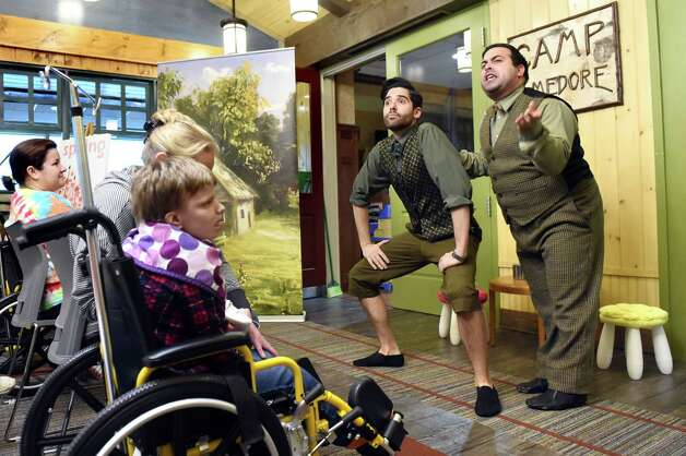 "Patients and families enjoy the Park Playhouse's production of ""A Year with Frog and Toad"" at the Bernard & Millie Duker Children's Hospital on Wednesday, Nov. 11, 2015, at Albany Medical Center in Albany, N.Y. Michael Wessels, left, is frog and Marc DeLaConcha is toad. (Cindy Schultz / Times Union) Photo: Cindy Schultz / 00034207A"