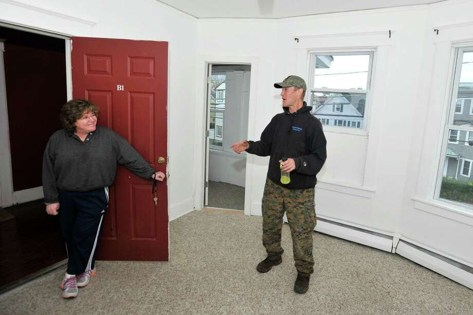Program Director of the Shelter for the Homeless Marie Johnson, left, talks with veteran George Hoffman after he moved into his own apartment on Wednesday, Nov. 11, 2015. Photo: Michael Cummo / Hearst Connecticut Media / Stamford Advocate