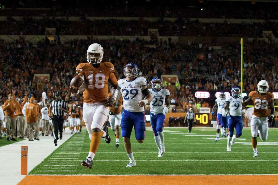 Though short-yardage situations have become his specialty, Texas QB Tyrone Swoopes (18) finishes off a 44-yard touchdown run against Kansas on Nov. 7. Photo: Cooper Neill, Stringer / 2015 Getty Images