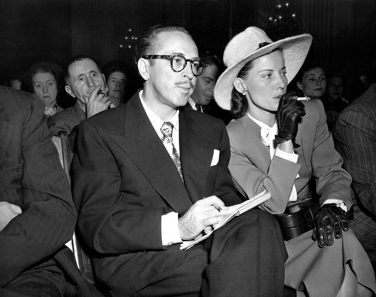 FILE - In this Oct. 28, 1947 file photo, screenwriter Dalton Trumbo, left, and his wife, Cleo, listen from the audience as the chairman of the House Un-American Activities Committee (HUAC) announces a contempt citation against Trumbo at a hearing in Washington, D.C. The new film