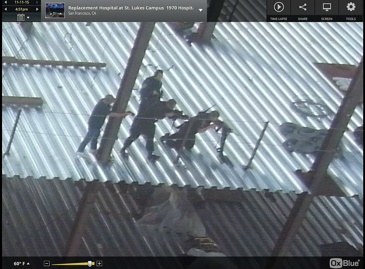 A screengrab from a time-lapse camera operated by OxBlue at a construction site near St. Luke's Hospital in the Mission District shows police on the scene of where an armed man was fatally shot by officers Wednesday, November 11, 2015.