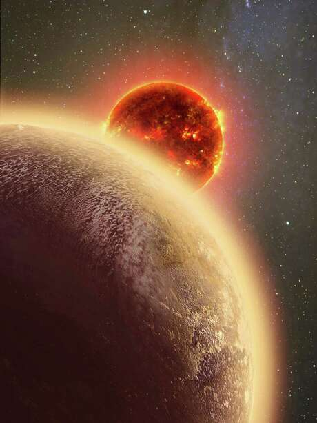 "This artist's conception made by Dana Berry of SkyWorks and provided by NASA on Nov. 6, 2015 shows GJ 1132b, foreground, a rocky planet similar to the Earth in size and mass, orbiting a red dwarf star. The planet is 39 light-years away - within the atmospheric study range of the Hubble Space Telescope. ""If we find this pretty hot planet has managed to hang onto its atmosphere over the billions of years it's been around, that bodes well for the long-term goal of studying cooler planets that could have life,"" said Massachusetts Institute of Technology's Zachory Berta-Thompson. (Dana Berry/SkyWorks/NASA via AP) Photo: Dana Berry, HONS / SkyWorks via NASA"