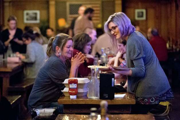 Cara Staib of Albany, right, brings small cheese pizzas to share with her mother, Shannon Staib, of Schoharie County on Thursday, Nov. 5, 2015, at City Beer Hall in Albany, N.Y. The pair were using one end of a long table where another couple was also seated. (Cindy Schultz / Times Union) Photo: Cindy Schultz / 00034106A