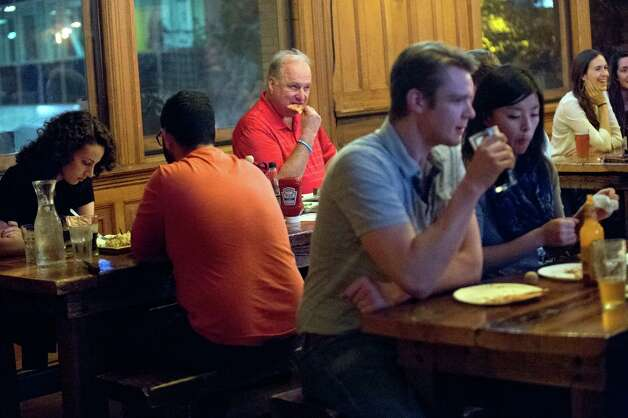 Diners share tables with strangers on Thursday, Nov. 5, 2015, at City Beer Hall in Albany, N.Y. (Cindy Schultz / Times Union) Photo: Cindy Schultz / 00034106A