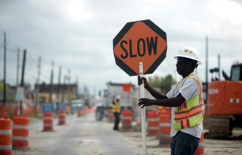 Road construction for a light rail line overpass along Harrisburg is delayed but on track to be completed in May. Photo: Cody Duty, Staff / © 2015 Houston Chronicle