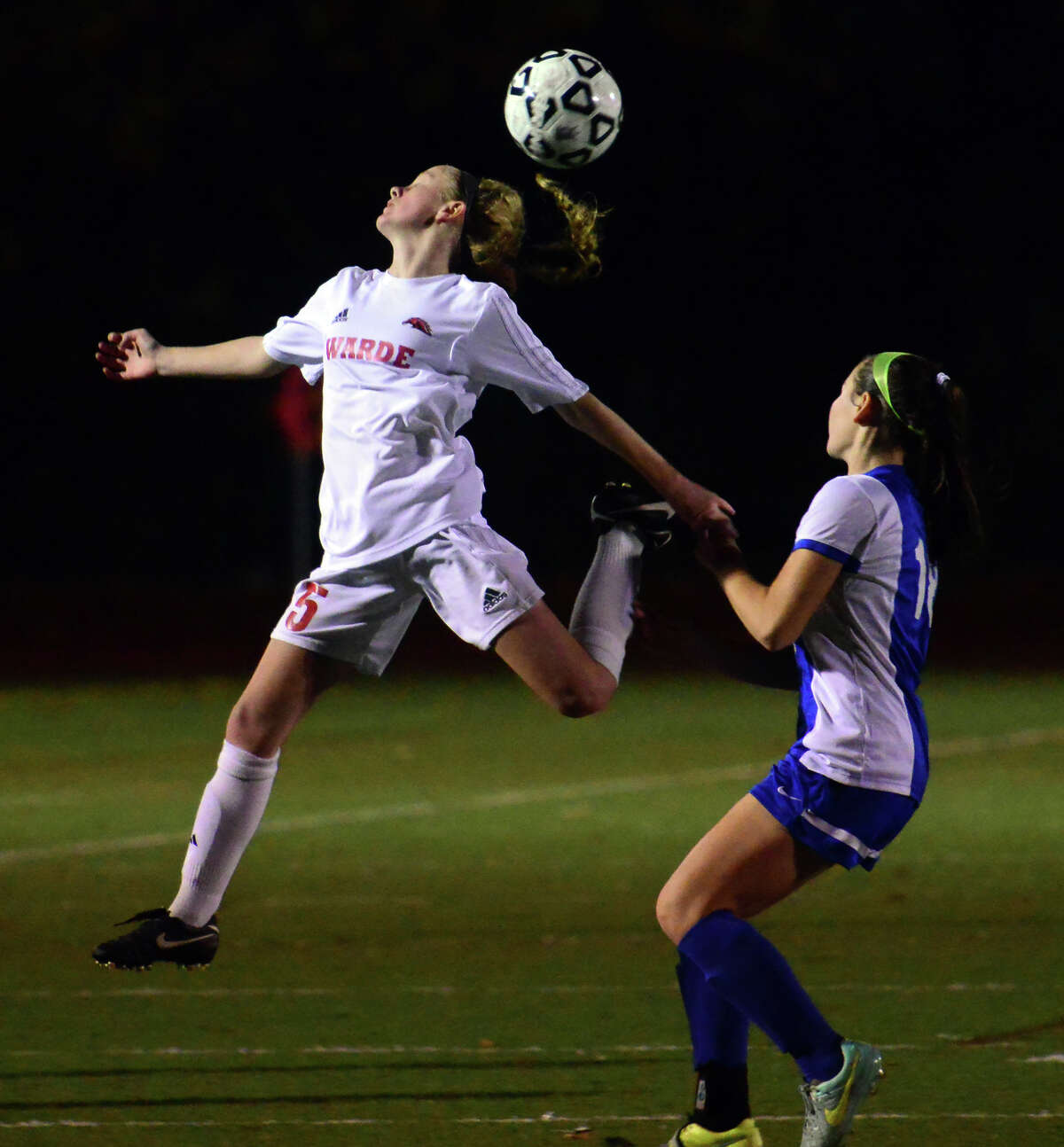 Fairfield Warde's Lauren Tangney heads the ball during second round of CIAC Girls Soccer Tournament action against Hall in Fairfield, Conn., on Wednesday Nov. 11, 2015.