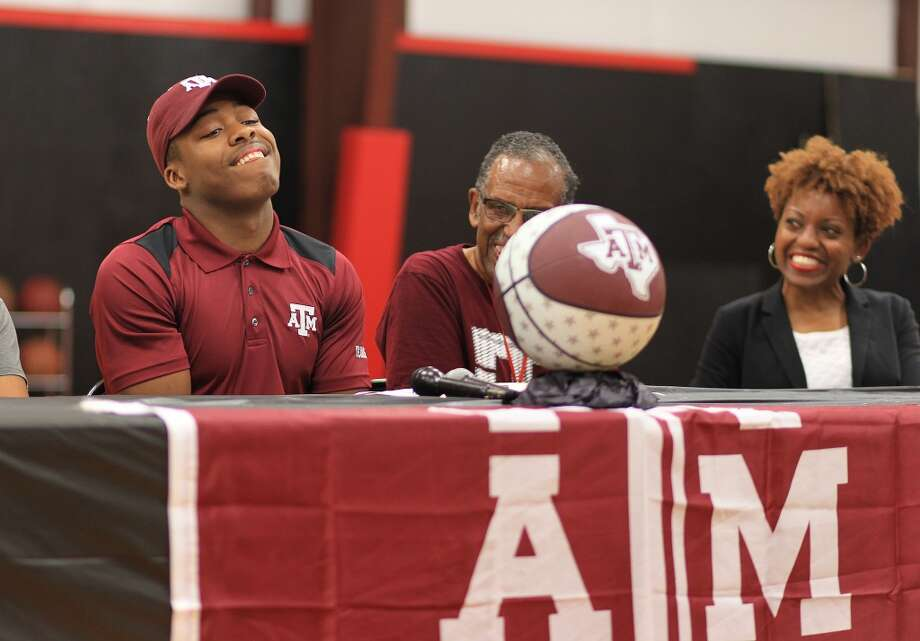 J.J. Caldwell reacts after signing his national letter of intent with Texas A&M University during a ceremony at Elevation Skills Sports in Cypress, Wednesday, Nov. 11, 2015. ( Mark Mulligan / Houston Chronicle ) Photo: Houston Chronicle