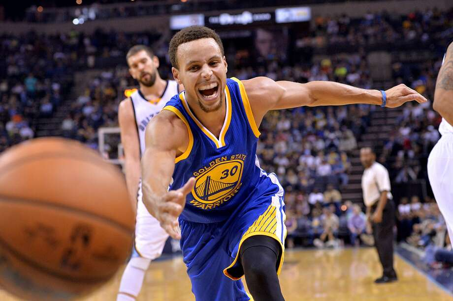 Golden State Warriors guard Stephen Curry (30) chases the ball after knocking it loose from Memphis Grizzlies guard Courtney Lee in the second half of an NBA basketball game, Wednesday, Nov. 11, 2015, in Memphis, Tenn. (AP Photo/Brandon Dill) Photo: Brandon Dill, Associated Press