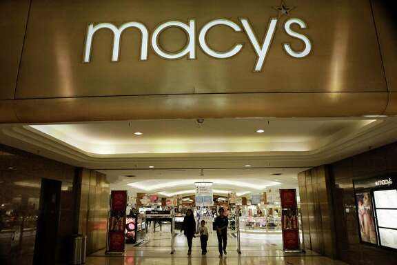 FILE - In this Feb. 20, 2011 file photo, the outside of a Macy's store is shown in Dallas.  Macy's cut its profit outlook and CEO Terry Lundgren said markdowns are likely as a convergence of factors lead to a high inventory of goods for retailers.  Shares of Macy's Inc. plunged more than 10 percent at the opening bell Wednesday, Nov. 11, 2015. (AP Photo/LM Otero)