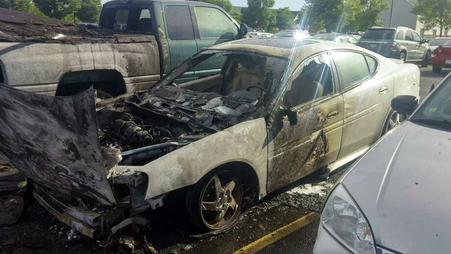 This photo provided by Joe Jarmoluk shows his fire-damaged 2004 Pontiac Grand Prix in a parking lot in Allendale, Mich. The fire, which started after Jarmoluk left the vehicle in the parking lot, totaled his car and several others.  Photo: Joe Jarmoluk, HONS / Joe Jarmoluk