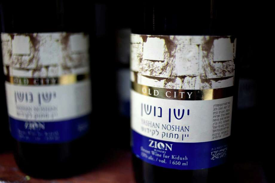 Bottles of wine  made in a Jewish settlement  in the  West Bank were on display Wednesday at a super-market in Jerusalem.  Photo: Ariel Schalit, STF / AP
