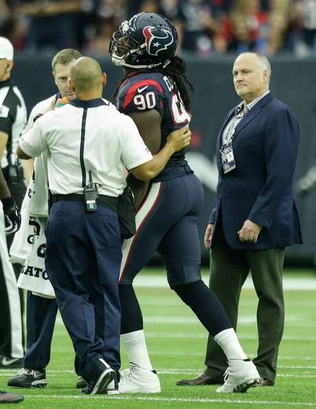 Texans linebacker Jadeveon Clowney, center, was injured in the first quarter against the Titans on Nov. 1 and has been hobbled, but he practiced Wednesday. Photo: Brett Coomer, Staff / © 2015  Houston Chronicle