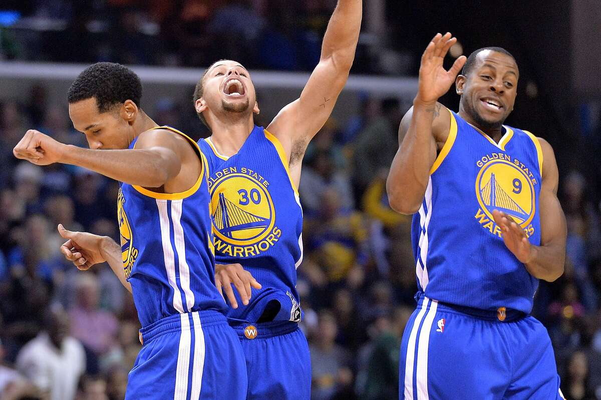 Golden State Warriors guards Shaun Livingston, left, Stephen Curry (30), and Andre Iguodala (9) celebrate after Curry's three-point score to beat the buzzer at the end of the third quarter during an NBA basketball game against the Memphis Grizzlies, Wednesday, Nov. 11, 2015, in Memphis, Tenn. (AP Photo/Brandon Dill)