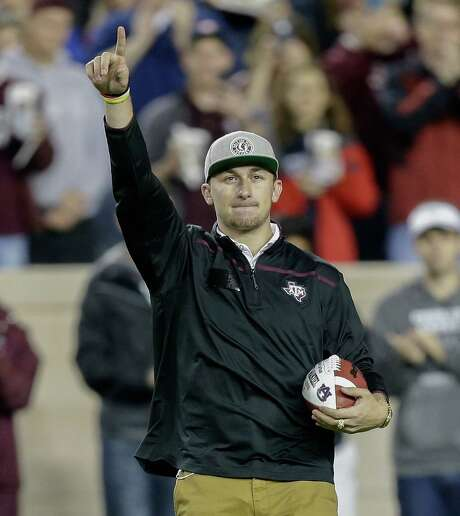 COLLEGE STATION, TX - NOVEMBER 07:  Former Texas A&M Aggies quarterback Johnny Manziel salutes the crowd at Kyle Field before the game against the Auburn Tigers on November 7, 2015 in College Station, Texas.  (Photo by Bob Levey/Getty Images) Photo: Bob Levey, Stringer / 2015 Getty Images