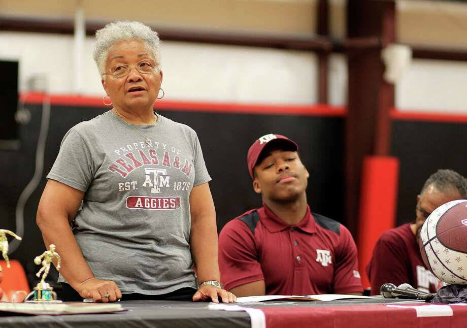 Hattie Caldwell, left, talks about her son J.J. during a ceremony Wednesday to celebrate the guard's signing a national letter of intent with Texas A&M. Photo: Mark Mulligan, Staff / © 2015 Houston Chronicle