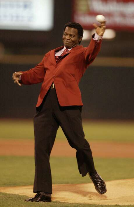 Cardinals Hall of Famer Lou Brock throws out the first pitch prior to the start of Game One of the National League Championship Series between the Houston Astros and the St. Louis Cardinals, at Busch Stadium, in St. Louis, Wednesday, October 12, 2005.  (Karen Warren/Houston Chronicle)     HOUCHRON CAPTION (10/13/2005) SECSPECIAL COLOR:  FIRST TOSS:  Former Cardinals great Lou Brock throws out the ceremonial first pitch before the start of Wednesday's game.    SPECIAL SECTION:  ASTROS PLAYOFFS 2005 Photo: Karen Warren, Staff / HOUSTON CHRONICLE