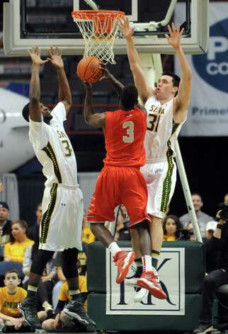 Siena's Imoh Silas, left, and Brett Bisping defend Stony Brook's Ahmad Walker during their first round College Basketball Invitational game at the Times Union Center on Tuesday March 18, 2014 in Albany, N.Y. (Michael P. Farrell/Times Union) Photo: Michael P. Farrell / 00026179A