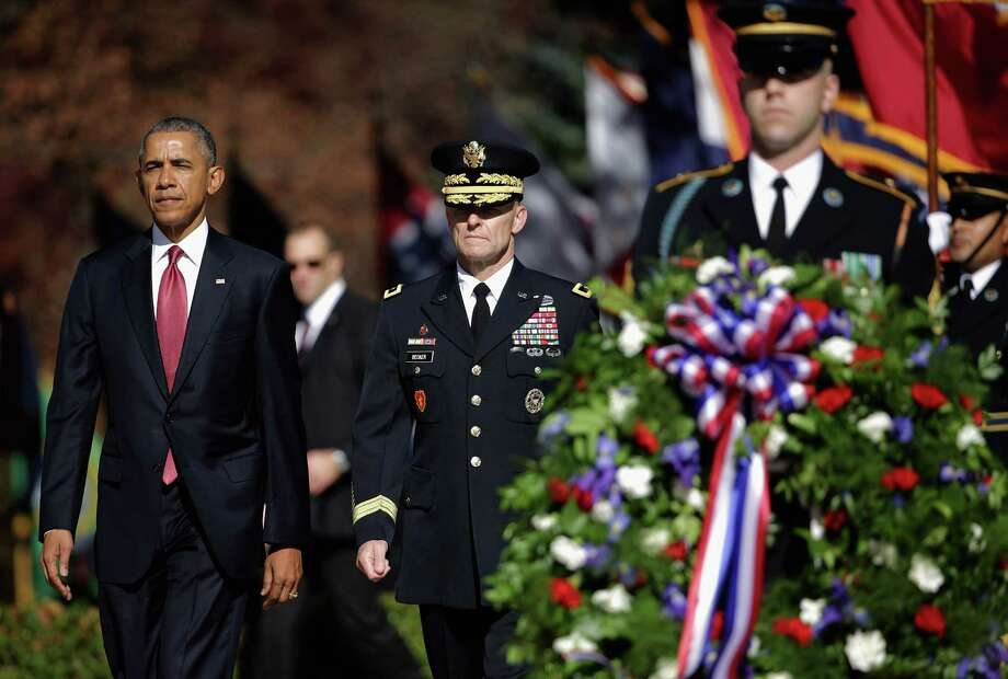 President Obama participates in a full honor wreath-laying ceremony at the Tomb of the Unknown Soldier to commemorate Veterans Day at Arlington National Cemetery in Arlington, Virginia. A reader reminds us that the loved ones of our men and women in uniform also serve. Photo: Chip Somodevilla /Getty Images / 2015 Getty Images