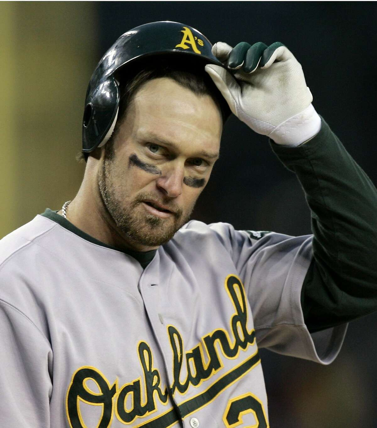 Oakland Athletics' Mark Kotsay takes off his helmet after striking out in the seventh inning leaving one man on in Game 4 of the American League Championship Series in Detroit, Saturday, Oct. 14, 2006.