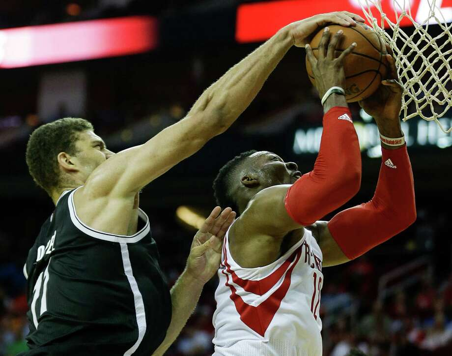 Brooklyn Nets center Brook Lopez (11) blocks a shot by Houston Rockets center Dwight Howard (12) during the second half of an NBA basketball game at Toyota Center Wednesday, Nov. 11, 2015, in Houston. Photo: Brett Coomer, Houston Chronicle / © 2015 Houston Chronicle