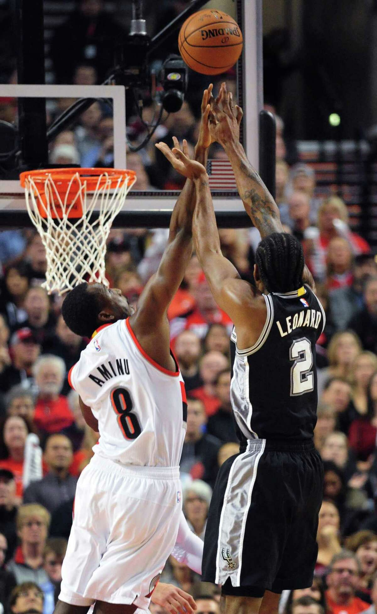 San Antonio Spurs forward Kawhi Leonard (2) shoots next to Portland Trail Blazers forward Al-Farouq Aminu (8) during the first quarter of an NBA basketball game in Portland, Ore., Wednesday, Nov. 11, 2015. (AP Photo/Steve Dykes)