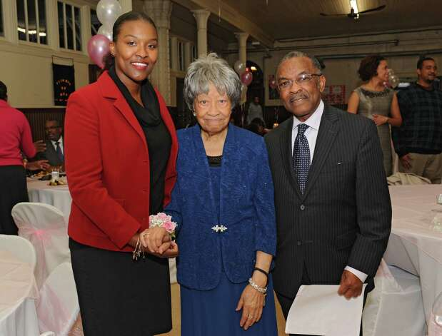 Sylvia Hill, known as Mother Hill, center, stands with her great niece Naomi Clarke of Albany, left, and Pastor Solomon Dees as members of Wilborn Temple Church of God in Christ celebrate her 100th birthday at Wilborn Temple on Wednesday, Nov. 11, 2015 in Albany, N.Y.  (Lori Van Buren / Times Union) Photo: Lori Van Buren / 00034206A