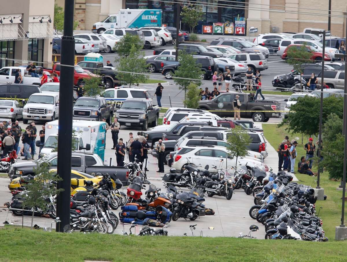 EDS NOTE: GRAPHIC CONTENT - Law enforcement officers investigate a shooting in the parking lot of the Twin Peaks Restaurant Sunday, May 17, 2015, in Waco, Texas. Waco police Sgt. W. Patrick Swanton told KWTX-TV there were multiple victims after gunfire erupted between rival biker gangs at the restaurant. (Rod Aydelotte/Waco Tribune Herald via AP)